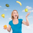 Happy Woman Juggling Produce