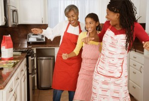 getty_rf_photo_of_women_dancing_while_cooking