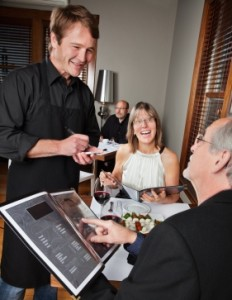 waiter-with-customers-iStock_000014531853XSmall