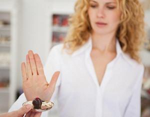 avoid-holiday-weight-gain-woman-refusing-chocolate-320