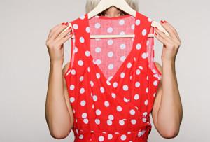 getty_rf_photo_of_woman_holding_dress