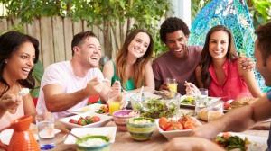Friends-Enjoying-Meal-Outdoors_207645049-760x428